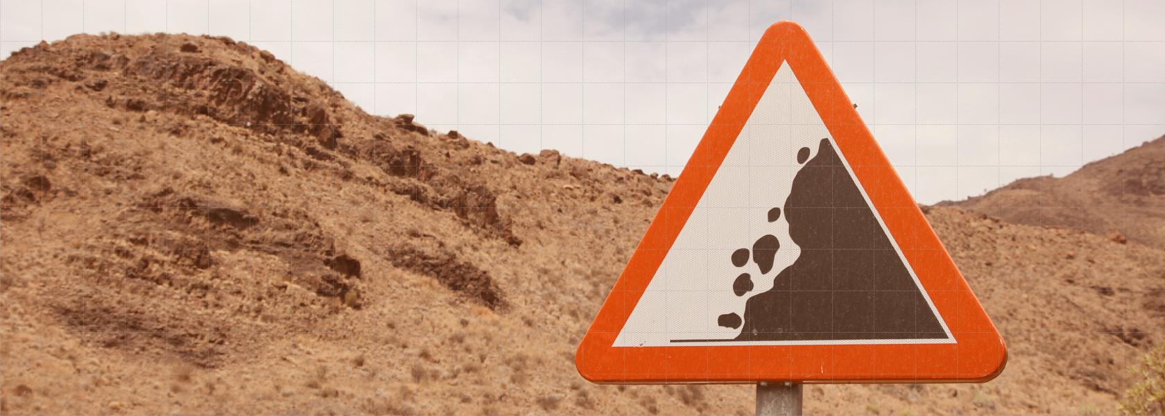 Sliderbild Startseite Monitoring System - Warnschild Erdrutsch